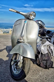 Vespa surounded with bags
