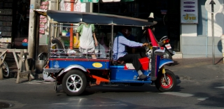 Polished TukTuk riding through the streets of Bangkok